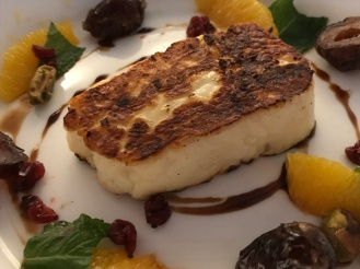 Seared halloumi cheese with dates, cashews, and tangerines